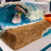 Surfing So Cal This surfing cake was created with a rice crispy wave, modeling chocolate surfer dude, complete with and beach towel, flip flops and cooler...