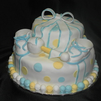 Baby Shower Cake   booties are fondant rattle is RKC and fondant