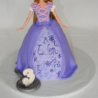 "Rapunzel Barbie Cake Made this for a friend's little girl. Cake is 3 6"" cakes, carved. Covered in fondant with all fondant detailing. The thing on the..."