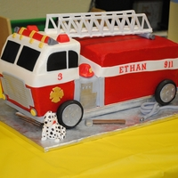 "Fire Truck Cake Made this for my son's 3rd birthday. Made it out of a 9x13 and three 6"" squares. Carved and stacked to make this shape. Iced in..."