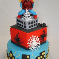 Spiderman Birthday Cake Similar to the other Spiderman cake I made. Got the Spiderman to be more upright this time. Spidey is all fondant, and I painted the black...