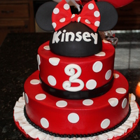 Minnie Mouse buttercream coated with fondant decorations, hat is RKT