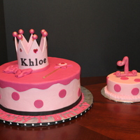 Crowned Pink crown is made of gumpaste, cake if buttercream with fondant details