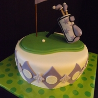 "Golfing Girl 10"" round all accents are gumpaste or fondant"