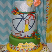 Carnival Girl Fondant layers. W/ hand painting, gum past balloons and hand made yarn flowers.