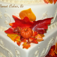 Falling In Love This is a fondant cake with buttercream scroll work. I hand made all the leaves, pumpkins, and acorns from gumpaste. The leaves are all...