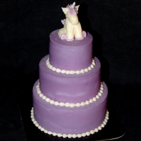 Mini Unicorn This is a mini 3 tier cake frosted in buttercream. The tiny unicorn on top is buttercream as well. I pipped it on parchment and then froze...