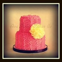 Pretty Pink Ruffle Butter cream with a tissue paper flower.