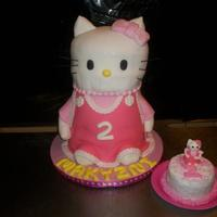 Hello Kitty W/matching Smash Cake   Chocolate cake with butter cream kitty. white smash cake