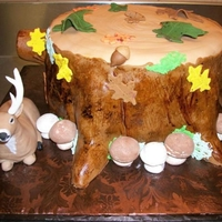 Stump And Buck   White and chocolate cake covered in fondant and hand made fondant deer and details.
