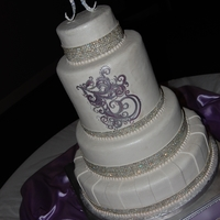 All Things Sparkly This cake was created for a wedding reception that was full of sparkle & drama! It is covered in fondant, with hand-painted details,...