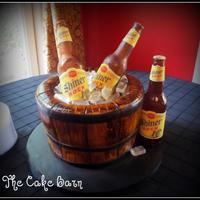 Bucket Of Shiner Beer We made this cake for a groom who loves Shiner Bock beer. This was our first time making sugar bottles!!! We were very pleased with how...