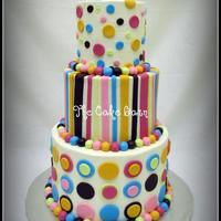 Girly Dots And Stripes Baby Shower Cake This buttercream baby shower cake with fondant accents was made to match the baby bedding. Edible pacifier as the topper. TFL!