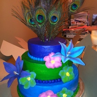 Peacocks And Flowers Bright jewel-toned buttercream with gumpaste flowers and faux-peacock feathers
