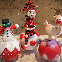Christmas Baubles cake toppers made out of gumpaste without moulds