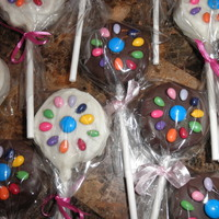 Daisy Scout Cake Pops Chocolate and vanilla cake pops decorated with the daisy made from candy coated sunflower seeds and an M&M center.....its for the...