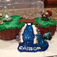 Skylanders Skylanders floating island. (Kids video game)Vanilla cake with almond buttercream and chocolate buttercream with toy characters. #8 sits on...