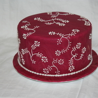 Birthday Cake Marblized burgundy fondant with piped flower design. Inspired by a Pink Cake Box design