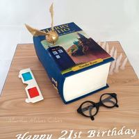Dr Who Harry Potter Cross Over Book Cake Dr Who / Harry Potter crossover book cake. All edible including wood grain floorboards. Gumpaste glasses with gelatine lenses.