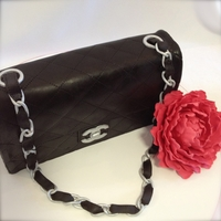 Chanel Cake Carved from GF Dark Chocolate mudcake for my daughters birthday. All edible including the chain and flower which were made from gumpaste.