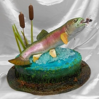 Rainbow Trout Cake This is my first attempt at such a cake. The trout is rice crispy treats with a wire armature, covered in fondant and airbrushed with food...