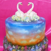 Swan Lake Wedding Cake This is a cake I did to 'match' the rainbow fish cake. It was based on a photo of a couple of swans on a lake, which had the...