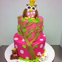Baby Owl Cake The cake is iced in butter cream and the owl is rice krispie treats covered in fondant,