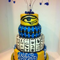 Egyptian Prom Cake This cake took 11 hours! But it was well worth it! I used lemon extract and gold pearl dust to make gold paint for the top tier. And the...