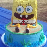 Spongebob Cake My first SpongeBob cake, SpongeBob is rice crispy w/buttercream and fondant decorations, cake is chocolate with buttercream.