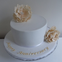 50Th Wedding Anniversary Cake Had the great pleasure of creating my in-laws 50th wedding anniversary cake. My first time attempting a peony flower and also my first time...
