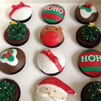 Christmas Cupcakes Double Chocolate Mud Cupcakes, chocolate buttercream, fondant decorations. Thanks for looking! xx