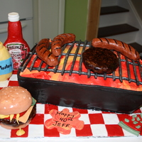 Bbq Cake I made this cake for my son's 40th birthday. Everything in this picture is edible except for the label on the ketchup bottle and the...