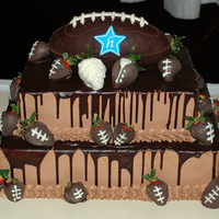 Football Cake 2 tier groom's cake, football made of RK and coverd in moddeling chocolate. Bottom tier is chocolate cake with cookies and cream, top...