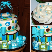It's A Boy   I'm verry happy how this one came out! first time trying vertical stripes, all fondant. TFL