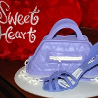 Purse And Shoe  First time making gumpaste shoe, purse is red velvet with white chocolate cream cheese filling, I'm not a big fan of purple but it was...