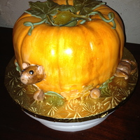 Thanksgiving Cake Pumpkin spice cake with cream cheese frosting and filling covered with fondant.