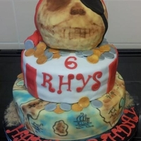 Pirate Cake   Design taken from another cake I had seen on this website. 2 tier cake with RKT skull.