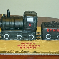 Steam Engine Train Cake A little boy wanted an old fashioned all black steam engine for his birthday. Covered in black MMF. The coal is made from broken up oreos....