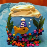 Fish Tank Cupcake Cupcakes decorated to look like fish tanks. I found the fun idea in a cupcake book. The cupcake is covered in icing and the fish is a...