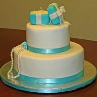 Breakfast At Tiffany's Bridal Shower Cake Chocolate Cake with raspberry ganache covered in MMF. The tiffany box is RKT covered in fondant. The ring is a pretend ring. Thanks to all...
