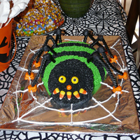 Spider Cake Based on the Wilton Spider cake. Covered in buttercream. The legs are black licorice. I used a 2 quart pyrex bowl for the body and a small...
