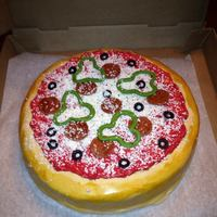 Pizza Cake  *Pizza cake (12 inch round, one layer) covered with fondant, fondant pepperoni, olives and peppers. Grated white chocolate for cheese and a...