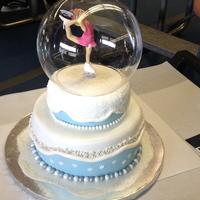 Figure Skating Snow Globe   fondant 2 tiered cake with pearl and dragee detail with acrylic globe. Figure skater made of fondant.