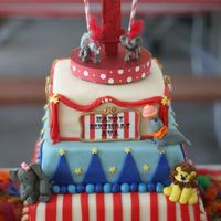 Carnival Cake carnival/circus themed cake with fondant figures and edible images all around of various carnival acts