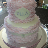 Ruffled Fondant Christening Cake   9 inch and 6 inch tiers ruffled wilton fondant with jewel embellishments.