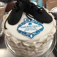 Irish Step Dancing Cake  fondant/tylose black soft shoes. I made billowed fondant puffs to mimic the look of Irish step dancing poodle socks and put silver drags...