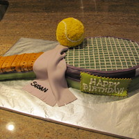"Tennis Birthday Cake Made this for a tennis friend of mine! Used oval pans, covered with findant, tennis ball is buttercream, and I used my pasta ""press&..."