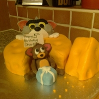 Tom & Jerry A choc sponge cake frosted with buttercream & fondant. Tom & Jerry made from gumpaste
