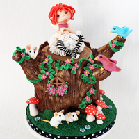 Tree Trunk Fairy Cake for my niece, I made the Tree Stump out of cake and chocolate ganache, the rest of the details are hand sculpted :) Enjoy!