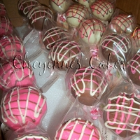 Cake Pops  i made these as favors to go with the pink wild safari cake that is in my photos. The last picture shows what she did with the cake pops. I...